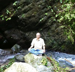 David meditating on a mountain stream