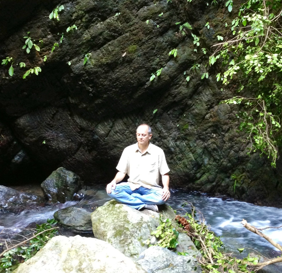 Talking to spirit - David meditating on a mountain stream