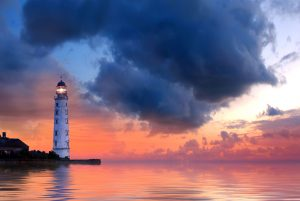lighthouse under storm clouds